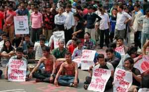 "Bangladeshi students and social activists protest against the killing of Avijit Roy, in Dhaka, Bangladesh, Friday, Feb. 27, 2015. Roy, a prominent Bangladeshi-American blogger, known for speaking out against religious fundamentalism was hacked to death by some unidentified people in the capital as he walked with his wife, police said Friday. Posters read, as ""we want punishment to Avijit Roy's killers.""  And  ""How many dead bodies we have to see?"" (AP Photo/ A.M. Ahad)"